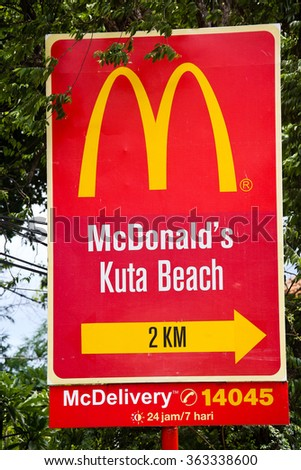 KUTA, BALI INDONESIA - DECEMBER 13 2014: McDonalds Street sign in Bali's tourist center - stock photo
