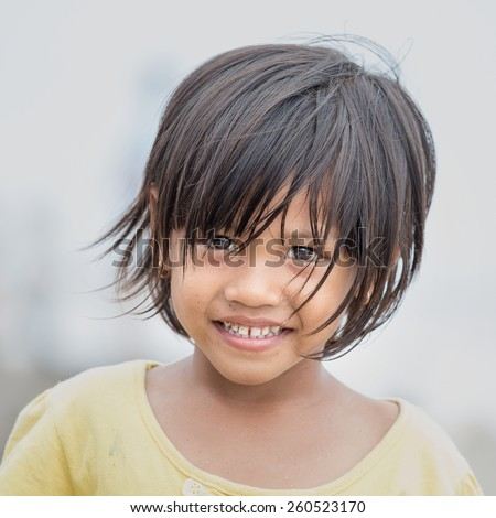 KUTA, BALI, INDONESIA - MARCH 13, 2015 : Unidentified portrait of a little indonesian child at the streets - stock photo