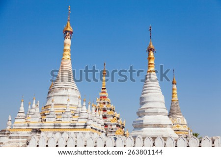 Kuthodaw Pagoda is a Buddhist stupa, located in Mandalay, Burma (Myanmar), that contains the world's largest book. - stock photo