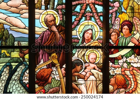 KUTNA HORA, CZECH REPUBLIC - AUGUST 23, 2014: The Holy Family, an Art Nouveau stained glass window in Saint Barbara Church in Kutna Hora, Czech Republic. - stock photo