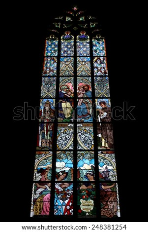 KUTNA HORA, CZECH REPUBLIC - MAY 5, 2013: The Holy Family. Art Nouveau stained glass window in Saint Barbara Church in Kutna Hora, Czech Republic. - stock photo