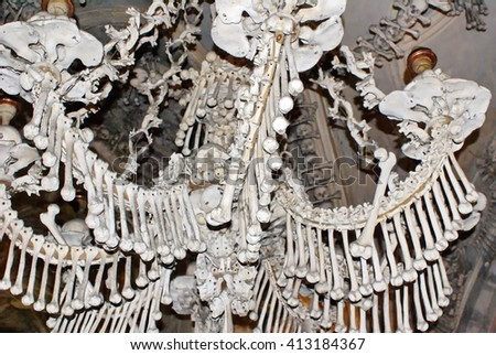KUTNA HORA, CZECH REPUBLIC - OCTOBER 10, 2010: Chandelier made from human bones in the Sedlec Ossuary