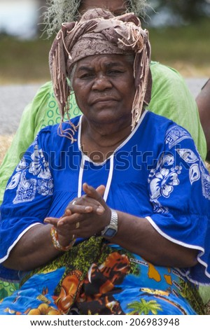 Kuto, Iles des Pins-January 8th 2014: A kanak female singer clapping during a song and dance performance. Melanesian Kanak are the main inhabitants of Kuto. - stock photo