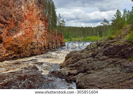 KUUSAMO, FINLAND - JULY 10, 2015: River Oulankajoki is heart of Oulanka National Park. Waters of 135-kilometre-long river originate from Salla mires and actual river begins at Lake Aittajarvi - stock photo