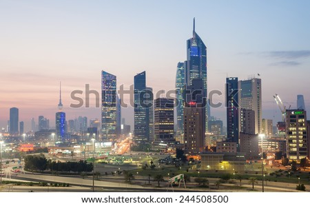 KUWAIT- DECEMBER 10: Skyscrapers in Kuwait City downtown illuminated at dusk. December 10, 2014 in Kuwait City, Middle East - stock photo