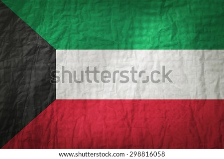Kuwait flag painted on a Fabric creases,retro vintage style - stock photo
