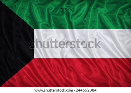 Kuwait flag pattern on the fabric texture ,vintage style - stock photo