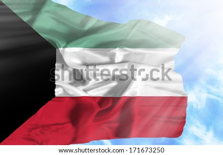 Kuwait waving flag against blue sky with sunrays - stock photo