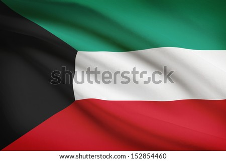 Kuwaiti flag blowing in the wind. Part of a series. - stock photo