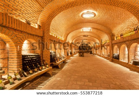 KVARELI, GEORGIA - OCT 3: Wine bottles waiting for tasting time inside huge cellar Khareba Winery with underground brick tunnel on October 3 2016. The tunnel was opened in 1962 for World Wine Congress