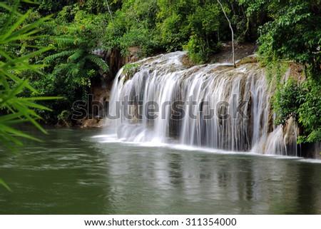 Kwai noi river and Saiyok Noi Waterfall, Kanchanaburi Province, Thailand - stock photo