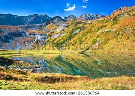Kyafar lake - one of the biggest in mountains of north Caucasus with panoramic view at the valley. Picture was taken during trekking hike in Caucasia at autumn, Arhiz region,Karachay-Cherkessia,Russia - stock photo