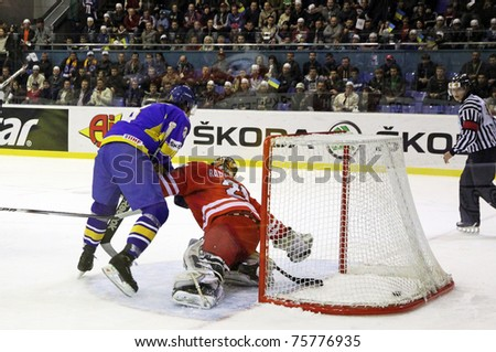 KYIV, UKRAINE - APRIL 20: Andriy Mikhnov of Ukraine (L) scores against Poland during their IIHF Ice-hockey World Championship DIV I Group B game on April 20, 2011 in Kyiv, Ukraine - stock photo