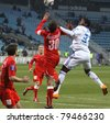 KYIV, UKRAINE - APRIL 2: Ayila Yussuf of Dynamo Kyiv (in White) fights for a ball with Kryvbas players (in Red) during their Ukraine Championship game on April 2, 2011 in Kyiv, Ukraine - stock photo