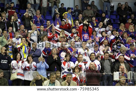 KYIV, UKRAINE - APRIL 23: Britain fans celebrate during IIHF Ice-hockey World Championship DIV I Group B game against Poland on April 23, 2011 in Kyiv - stock photo
