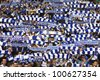 KYIV, UKRAINE - APRIL 14: FC Dynamo Kyiv team supporters show their support during Ukraine Championship game against Vorskla Poltava on April 14, 2012 in Kyiv, Ukraine - stock photo