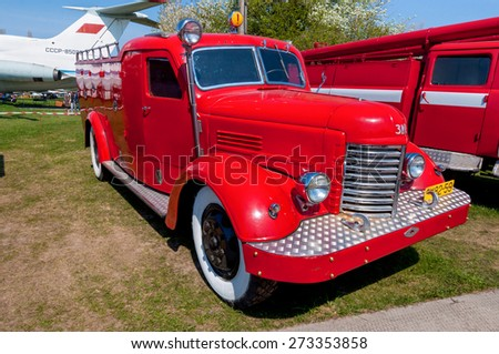 """KYIV, UKRAINE - APRIL 26: The festival """"Old Car Fest 2015"""", showed an fire truck ZIS-150 vintage model on April 26, 2015 in Kiev, Ukraine - on the territory of the Kyiv State Aviation Museum. - stock photo"""