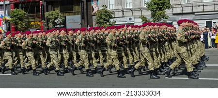 KYIV, UKRAINE - AUGUST 24 2014: A military parade march in the central street at the Independence Day in the Ukrainian capital KIEV, UKRAINE - AUGUST 24 2014.