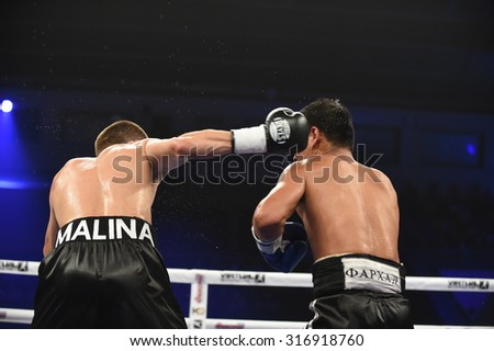 Kyiv, UKRAINE - August 29, 2015 : An unidentified boxers in the ring during fight for ranking points in the Palaceof Sport in Kiev, Ukraine