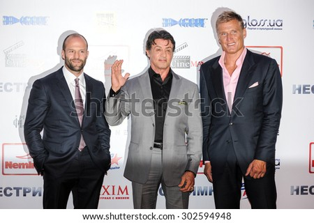 "KYIV, UKRAINE - August 07, 2010: Sylvester Stallone, Jason Statham and Dolph Lundgren at the ""The Expendables"" Film premiere in Kiev, Ukraine. - stock photo"