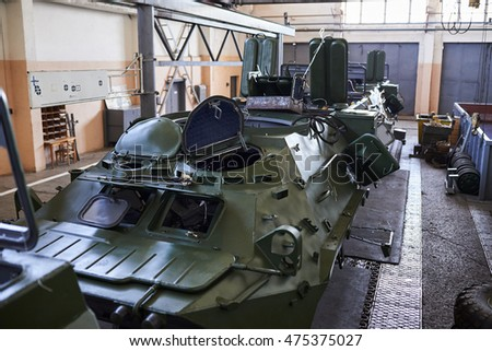 KYIV, UKRAINE - AUGUST 29, 2016: Ukrainian workers modernize an Armored Personnel Carrier (APC) for the Ukrainian forces, at the Kiev armored plant, in Kiev, Ukraine, 29 August 2016.