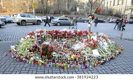 KYIV, UKRAINE - CIRCA MARCH, 2014: Memorial mournful flowers and candls on European square for perished  protesters of mass shooting of at 18-20 February 2014
