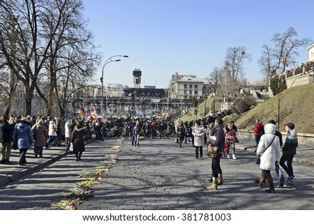 KYIV, UKRAINE - CIRCA MARCH, 2014: Place of mass shooting of protesters at 18-20 February 2014 on Institutska street. The Mortal road is laid  by flower
