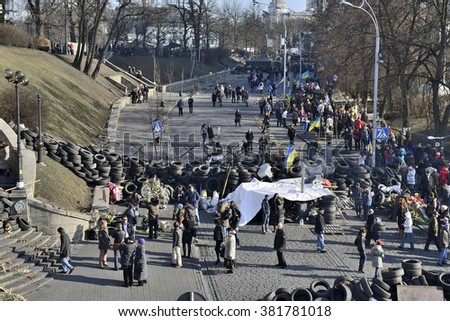 KYIV, UKRAINE - CIRCA MARCH, 2014: Place of mass shooting of protesters at 18-20 February 2014 on Institutska street. Peoples between Restored barricades from tyres