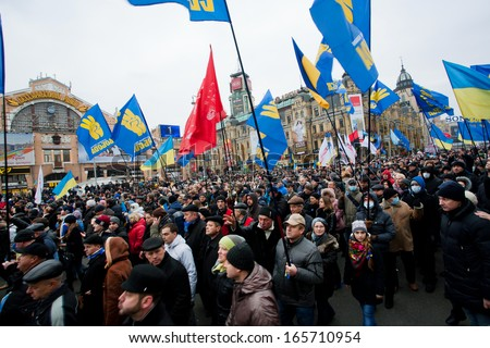 KYIV, UKRAINE - DEC 1: Crowd of 800,000 demonstrators with national flags on anti-government demonstration paralyzed traffic during the pro-European protest on December 1, 2013 in Kiev, Ukraine - stock photo