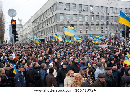 KYIV, UKRAINE - DEC 1: Crowd of 800,000 people with national symbols on anti-government demonstration paralyzed traffic during the pro-European protest on December 1, 2013 in Kiev, Ukraine - stock photo