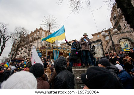 KYIV, UKRAINE - DEC 2: Crowd of the revolutioners occupying city center  with anti-government demonstration during the week of pro-European protest on December 2, 2013 in Kiev, Ukraine - stock photo