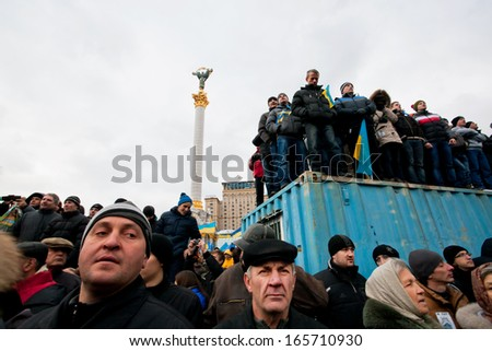 KYIV, UKRAINE - DEC 2: Many people occupying trailers standing on anti-government demonstration during the week of pro-European protest on December 2, 2013 in Kiev, Ukraine - stock photo
