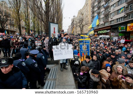 KYIV, UKRAINE - DEC 1: Many people walking to the anti-government demonstration past the police forces during  the pro-European protest on December 1, 2013 in the center of Kiev, Ukraine   - stock photo