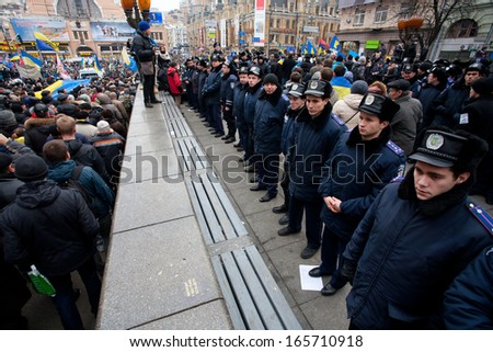 KYIV, UKRAINE - DEC 1: Members of the police forces guarding the last monument of the communist leader Lenin during the pro-European protest on December 1, 2013 in the center of Kiev, Ukraine   - stock photo