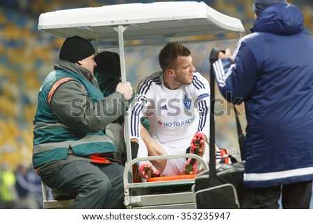 KYIV, UKRAINE - DECEMBER 10, 2015: Football Champions League game. Dynamo Kyiv against Maccabi Tel Aviv. The injured player Andriy Yarmolenko.