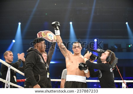 Kyiv, UKRAINE - December 13, 2014 : Oleksandr Usyk (Ukraine) in the ring during fight for WBO Inter-Continental cruiserweight title in the Palace of sport