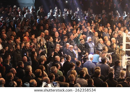 KYIV, UKRAINE - DECEMBER 13, 2014: People sing the National Anthem of Ukraine before WBO Intercontinental Cruiserweight Title fight between Oleksandr Usyk (Ukraine) and Danie Venter (South Africa) - stock photo