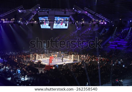 "KYIV, UKRAINE - DECEMBER 13, 2014: Tribunes of Palace of Sports in Kyiv during ""Evening of Boxing"" - stock photo"