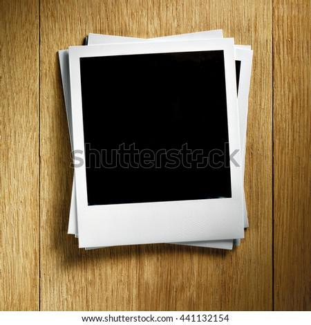 KYIV, UKRAINE - FEB 13, 2014: Polaroid photo cards on wooden background.  - stock photo