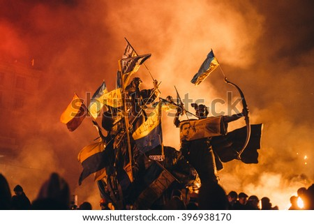 Kyiv, Ukraine - February 18, 2014: Barricades in the conflict zone on Maidan Nezalezhnosti. Ukrainian police are storming the main anti-government protest camp in the Kyiv, Ukraine revolution. - stock photo