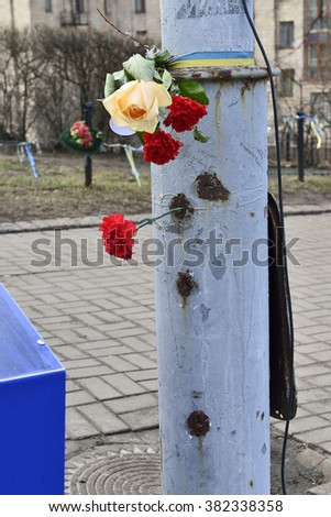 KYIV, UKRAINE - FEBRUARY 21, 2016: Euromaidan, Second anniversary of mass shooting at 18-20 February 2014 on Institutska street. Holes from bullets on steel shelled up pillar