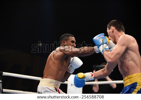 Kyiv, UKRAINE - February 27, 2015 : Hurshidbek Normatov (Ukraine)  and Arlen Lopez (Cuba) in the ring during boxing fight Ukraine Otamans vs Cuba Domadores in Palace of Sport in Kiev, Ukraine