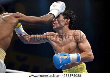 Kyiv, UKRAINE - February 27, 2015 : Omurbek Malabekov (Ukraine)  and Andy Cruz Gomez (Cuba) in the ring during boxing fight Ukraine Otamans vs Cuba Domadores in Palace of Sport in Kiev, Ukraine