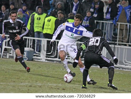 KYIV, UKRAINE - FEBRUARY 24: Roman Eremenko of Dynamo Kyiv (C) fights for a ball with Ibrahim Toraman of Besiktas (R) during their UEFA Europa League game on February 24, 2011 in Kyiv, Ukraine