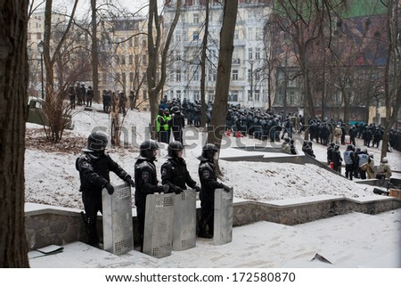KYIV, UKRAINE - JAN 21: Police squads hide in the park and wait for the order to attackon on the occupying snow street during anti-government protest Euromaidan on January 21, 2014, in Kiev, Ukraine. - stock photo