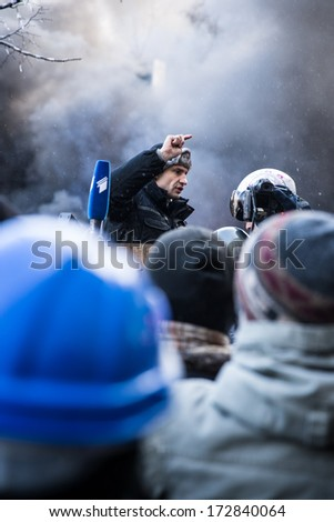 KYIV, UKRAINE - JAN 23: Vitaliy Klitschko on the occupying street on the demostration during anti-government protest Euromaidan on January 23, 2014, in center of Kiev, Ukraine - stock photo