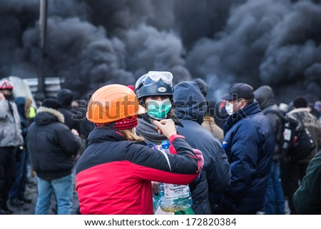 KYIV, UKRAINE - JAN 23: Women on the occupying street on the demostration during anti-government protest Euromaidan on January 23, 2014, in center of Kiev, Ukraine - stock photo