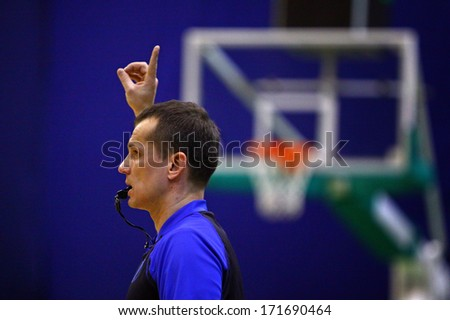 KYIV, UKRAINE - JANUARY 15, 2014: Basketball referee in action during Basketball EuroCup game between Budivelnik Kyiv and Union Olimpija Ljubljana