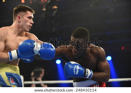 Kyiv, UKRAINE - January 23, 2014 : Haizel Ekow Tabiri-Essuman and Bogdan Shelestyuk  in the ring during boxing fight Ukraine Otamans vs British Lionhearts in Acco International center in Kiev, Ukraine