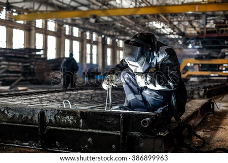 Kyiv, Ukraine - January 27, 2016: Old factory for concrete production. The staff and workers of the old workshop of concrete production. Technological processes of concrete production